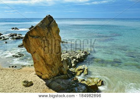 the Mediterranean sea and a peculiar rock at Platja de Lloret beach in Lloret de Mar,in the Costa Brava, Spain