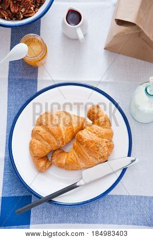 Continental breakfast - Two croissants on a white plate