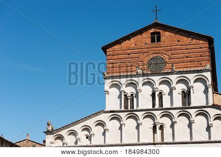 Detail of the church of Santa Maria Forisportam in Pisan-romanesque style (XII century) in the ancient town of Lucca Toscana (Tuscany) Italy Europe