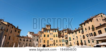 Historic buildings in Piazza dell'Anfiteatro (Amphitheater Square) in the ancient town of Lucca Toscana (Tuscany) Italy Europe