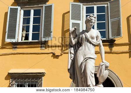 Neoclassical statue of a Naiad (Pupporona - one of the symbols of Lucca) in the Misericordia square. Lucca Tuscany Italy