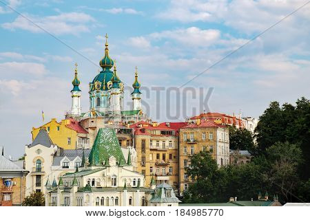 Kiev, Ukraine - September 11, 2016: St. Andrew's Church on reconstruction and the old houses on the St. Andrew's Descent street in Kyiv.