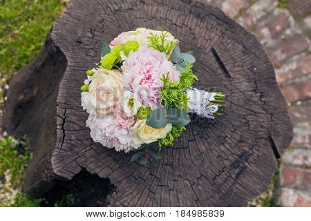 Bridal bouquet on wooden background.