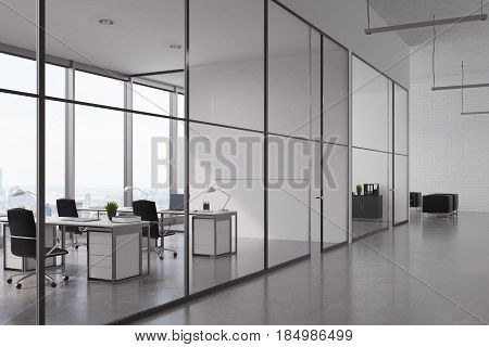Open office interior with a glass wall rows of tables with computers on them and panoramic windows. 3d rendering mock up