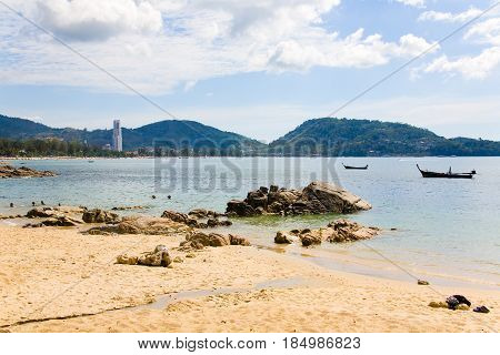 Patong Thailand February 4 2017: View of the beach high-rise building and boats at low tide.