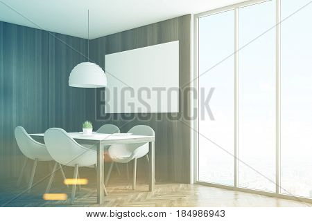 Side view of a kitchen corner with dark wooden walls a horizontal poster hanging above a table with four chairs and a panoramic window. 3d rendering mock up toned image