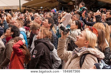 Prague, Czech Republic - April 15, 2017: Tourists Watching The Hourly Show Of The Astronomical Clock