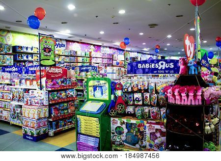 Dumaguete Philippines - 26 November 2016: Toy department in shopping mall. Children desires parents present concept. Shiny attractive games and toys. Colorful toys for baby. Toy selling industry