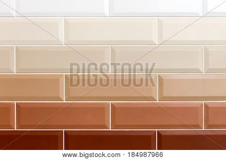 Background in the form of bricks. Ceramic brick tiles. Gradient color. Close-up