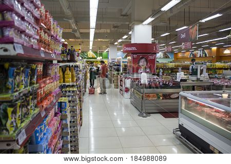 Dumaguete Philippines - 26 November 2016: Food supermarket in shopping mall. Asian supermarket. Shopping mall banner template. Sweets and desserts on shop display. Buyer and seller in shop interior
