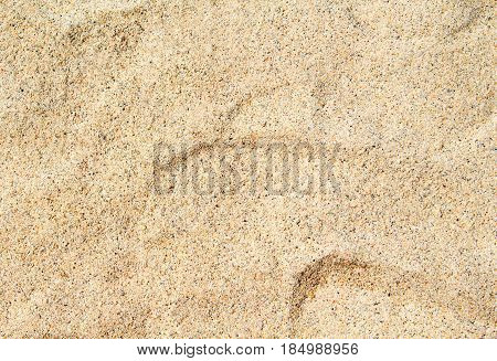 Warm beach sand closeup for background. Tropical beach photo. Exotic island sandy beach texture. Soft sand surface backdrop for vacation template holiday card or banner. Seaside coral sand surface