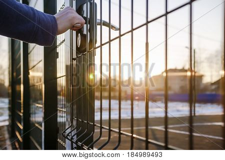 person wants get in on playground through the little gate of the welded wire mesh wonderful winter sunny day