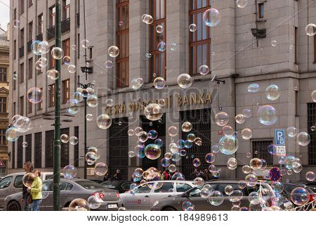 PRAGUE, CZECH REPUBLIC - APRIL 21, 2017: The building of the Czech National Bank with colorful bubbles floating around