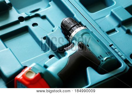 Screwdriver in a blue case close up