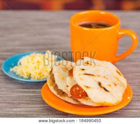 Traditional delicious arepas, shredded chicken avocado and cheddar cheese and shredded beef.