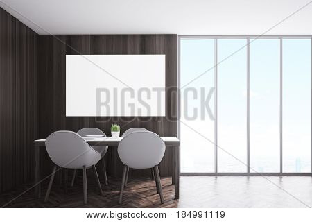 Kitchen corner with dark wooden walls a horizontal poster hanging above a table with four chairs and a panoramic window. 3d rendering mock up