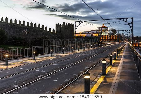 Walls of D. Fernando and bridge of Dom Luis I in Porto city Portugal