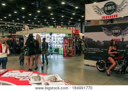 St. Petersburg Russia - 15 April, Photomodels at the motor show,15 April, 2017. International Motor Show IMIS-2017 in Expoforurum. Visitors and participants of the annual moto-salon in St. Petersburg.