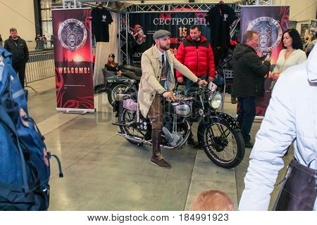 St. Petersburg Russia - 15 April, A man on a motorcycle among visitors,15 April, 2017. International Motor Show IMIS-2017 in Expoforurum. Visitors and participants of the annual moto-salon in St. Petersburg.
