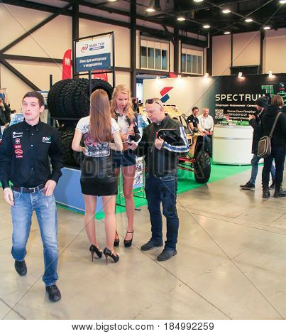 St. Petersburg Russia - 15 April, People at the motor show,15 April, 2017. International Motor Show IMIS-2017 in Expoforurum. Visitors and participants of the annual moto-salon in St. Petersburg.