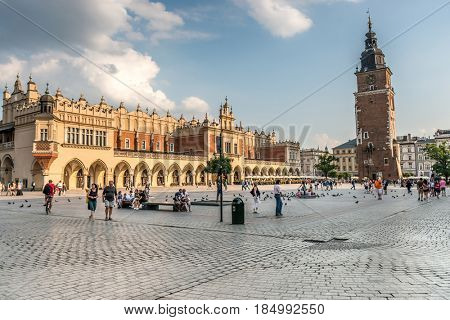 POLAND, KRAKOW- JULY 01: Amazing arched palace and a tower with clock, cobbled square in Krakow Poland on July 01, 2015