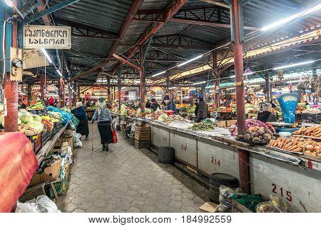KUTAISI, GEORGIA, NOVEMBER, 05: Long rows of homegrown farmer's fresh vegetables in Kutaisi, georgian marketplace, bazaar on nowember, 05, 2016 in Georgia