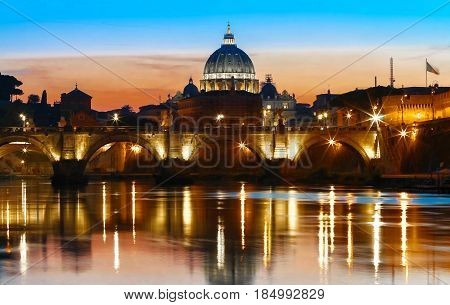 The sunset view of the Vatican with Saint Peter's Basilica and Sant'Angelo's Bridge Rome Italy.