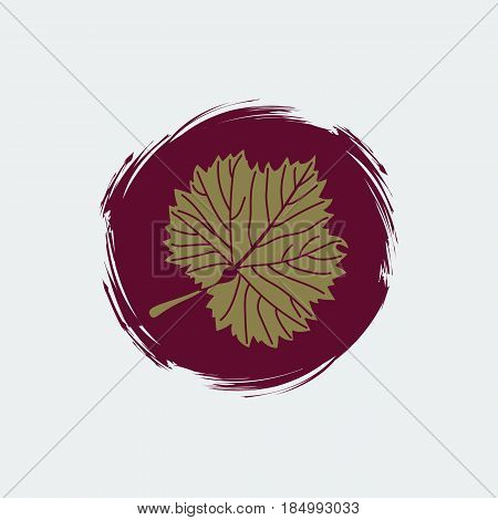 Gold grape leaf on round burgundy background