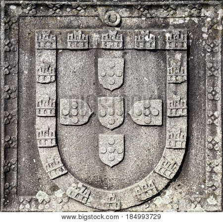 Portuguese Coat of Arms used by the Portuguese kings between 1248 and 1385 carved in granite stone. It is located in Ponte de Lima Portugal