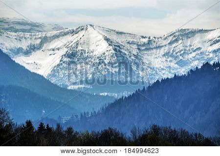 Snowy mountains in bavarian alps against cloudy sky tourist resort landscape in bavaria germany europe copy space