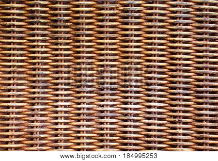 Wicker wooden background. Rattan woven top view closeup. Rattan chair interlace of natural material. Ecologic craft. Golden basketry furniture. Asian handcraft banner template picture. Tradition weave