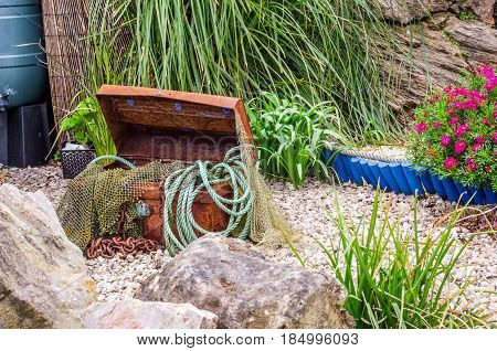 Big Box Of Fishing Tools, Nets, Ropes, Fishing Industry, Ocean Shore, Plants And Flowers