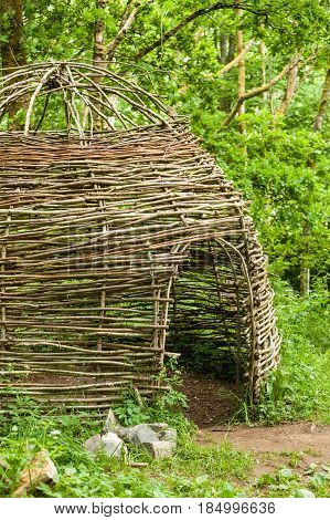 Small Cottage Made Of Wooden Sticks In Woods