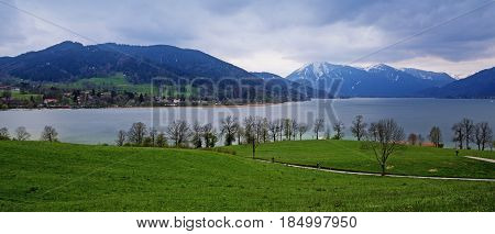 panoramic view at the tegernsee lake and the blue and snow covered mountains in the famous tourist resort Bavarian Alps Bavaria Germany Europe