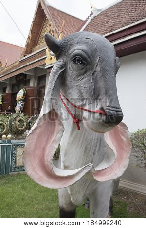 Statue of a cow in temple thailand.
