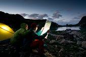 couple camping at night poster