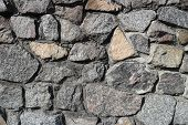 Rubble gray stone wall rubble work . poster