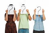 Three casual people standing in a line and holding questions marks isolated on white background poster