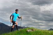 Nordic walking a man in nature in the mountains train poster