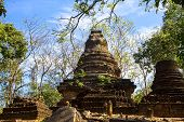 Wat Khao Phanom Phloeng and old pagoda sky in Sisatchanalai Historical Park Sukhothai province Thailand poster