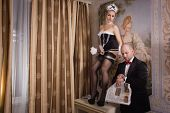 Sexual chambermaid bothers the guest who reads the newspaper. poster