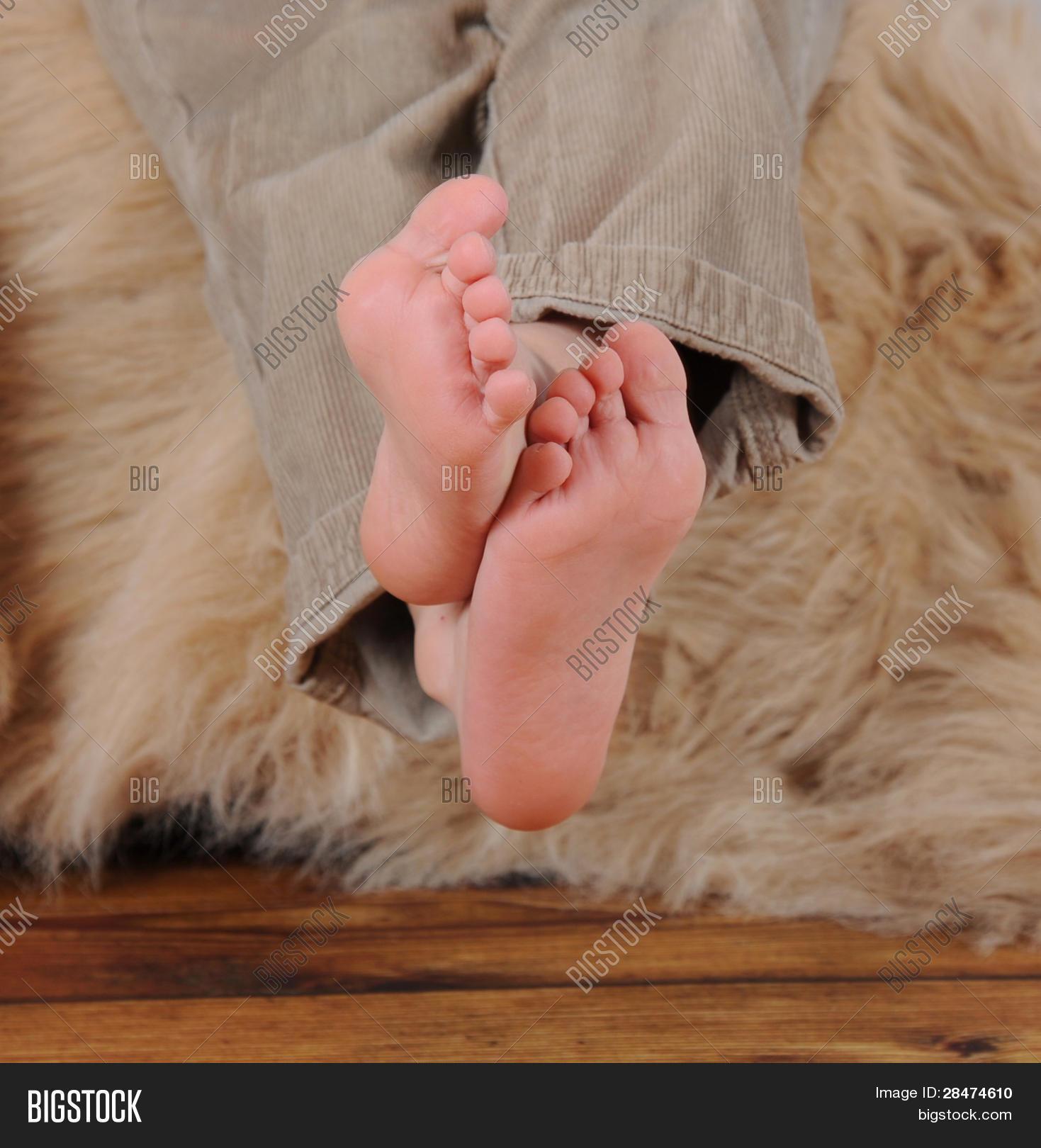 Close Up Of Little Boys Bare Feet