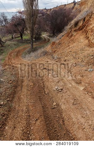 Unpaved Country Road Without Asphalt. A Rough Nameless Dirt Road On The Outskirts Of Ukraine. Stony