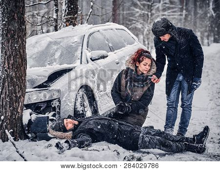 Witness Of The Accident Helps The Injured Couple To Contact The Rescue Service. The Car Got Into A S