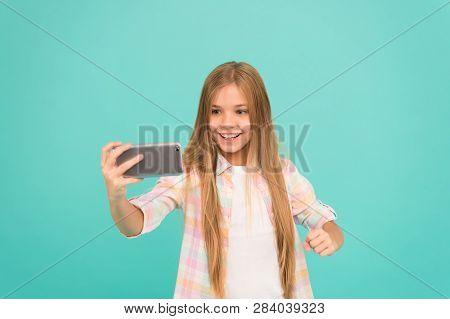 Video Call Concept. Girl Hold Smartphone Taking Selfie. Selfie For Social Networks. Streaming Online