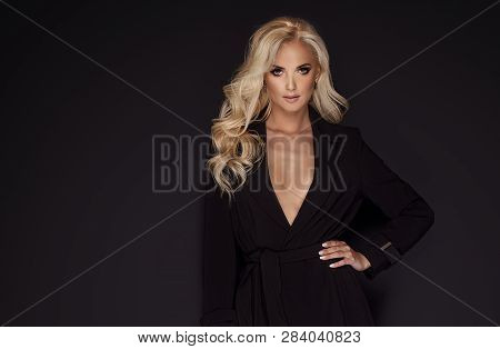 Young Woman In Black Coat.