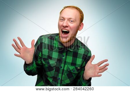Portrait Of Red Haired Happy Man Show His Hands. Caucasian Teenager Maked Surprise. Redhead Guy Scre
