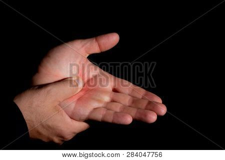 Man's Hands With Pain In The Palm Of The Hand. Massage In The Palm With The Thumb. Hands Of Young Wh