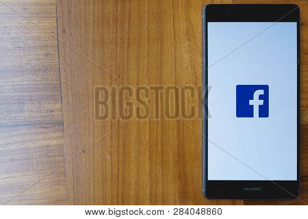 Chiang Mai, Thailand - Mar 28,2018: Huawei With Facebook App On The Screen On Wooden Table. Facebook