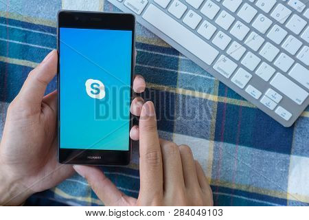 Chiang Mai, Thailand - Mar 28,2018: Man Holding Huawei With Skype Apps On Screen. Skype Is Part Of M